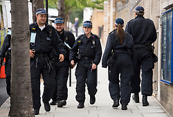 © Licensed to London News Pictures. 30/08/2020. London, UK. Large numbers of police gather in Notting Hill, West London, on the first day of the 2020 Notting Hill Carnival, which is being held virtually this year due to COVID-19 restrictions. Members of the public have been warned against congregating in the Notting Hill Area to celebrate the event. Photo credit: Ben Cawthra/LNP