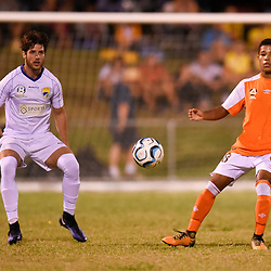 BRISBANE, AUSTRALIA - FEBRUARY 10: Acim Tomic of United and Bryce Bafford of the Roar in action during the NPL Queensland Senior Mens Round 2 match between Gold Coast United and Brisbane Roar Youth at Station Reserve on February 10, 2018 in Brisbane, Australia. (Photo by Football Click / Patrick Kearney)