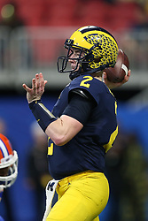 Michigan Wolverines quarterback Shea Patterson #2 throws a pass during the Chick-fil-A Peach Bowl, Saturday, December 29, 2018, in Atlanta. (Jason Parkhurst via Abell Images for Chick-fil-A Peach Bowl)