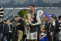 May 19, 2019 - Turin, Turin, Italy - Sami Khedira of Juventus FC lifts  the trophy of Scudetto  2018-2019 at Allianz Stadium, Turin (Credit Image: © Antonio Polia/Pacific Press via ZUMA Wire)