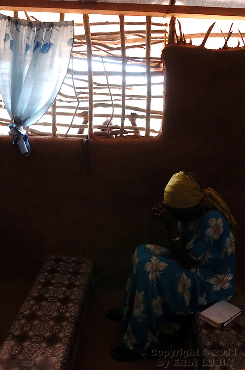 A member of the Gambella community from Ethiopia attends service at the God Help Christian Fellowship Church inside Ifo Refugee Camp, Dadaab, Kenya September 15, 2006. ..Photograph by Erin Lubin