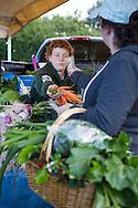 LIVING OFF THE GRID<br /> Leo Castellani at the Farmer's Market in Homer, Alaska.<br /> Anchor Point, Alaska, USA