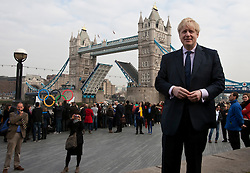 © licensed to London News Pictures. London, UK 28/02/2012.  Mayor of London, Boris Johnson is pictured with Olympic rings and Tower Bridge as the rings are being carried on River Thames with a floating platform this morning. Photo credit: Tolga Akmen/LNP