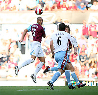 Photo: Chris Ratcliffe.<br /> West Ham United v Aston Villa. The Barclays Premiership. 10/09/2006.<br /> Gareth Barry of Aston Villa clashes with Bobby Zamora of West Ham.