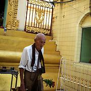 May 09, 2013 - Yangon, Myanmar: A local man at Sule Pagoda in central Yangon. CREDIT: Paulo Nunes dos Santos