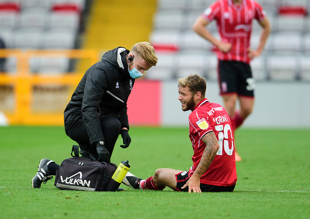 Lincoln City's Jorge Grant receives treatment from Lincoln City's head of sports science and medicine Mike Hine<br /> <br /> Photographer Andrew Vaughan/CameraSport<br /> <br /> The EFL Sky Bet League One - Lincoln City v Charlton Athletic - Sunday 27th September, 2020 - LNER Stadium - Lincoln<br /> <br /> World Copyright © 2020 CameraSport. All rights reserved. 43 Linden Ave. Countesthorpe. Leicester. England. LE8 5PG - Tel: +44 (0) 116 277 4147 - admin@camerasport.com - www.camerasport.com