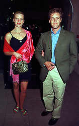 MISS SOPHIA BURRELL she was recently photographed for a controversial picture in Country Life magazine and MR PETER THOMPSON, at a party in London on 14th September 1999.MWI 39