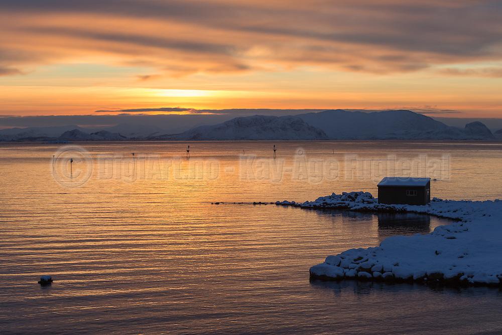 The sun shines beautifully over the sa nearby Fosnavåg, Norway   Solen skinner vakkert over Søre Vaulen ved Fosnavåg.