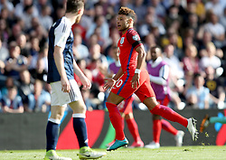 England's Alex Oxlade-Chamberlain celebrates scoring his side's second goal during the 2018 FIFA World Cup qualifying, Group F match at Hampden Park, Glasgow.
