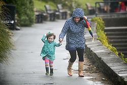 © Licensed to London News Pictures. 25/08/2020. City, UK. A women and child struggle in the strong winds at Langland Bay, Gower, as Storm Francis brings poor weather conditions across the UK with high winds and heavy rain causing disruption. Photo credit: Robert Melen/LNP