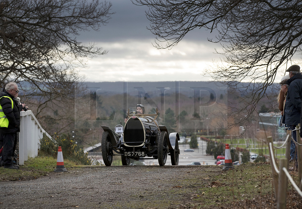© Licensed to London News Pictures. 28/01/2018. Weybridge, UK. Ed Burgess steers his 1924 Bugatti T13 Brescia to the top of the steep gradient on the hill test at Brooklands Museum during The Vintage Sports-Car Club's New Year driving tests.  Photo credit: Peter Macdiarmid/LNP