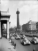 The army's armoured car division passes by the General Post Office and Nelson's Pillar during the Easter Sunday Military Parade in Dublin..22.04.1962