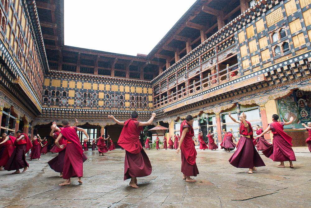 Dancing monks, Paro, Bhutan<br /> <br /> Full photoessay at http://xpatmatt.com/photos/bhutan-photos/
