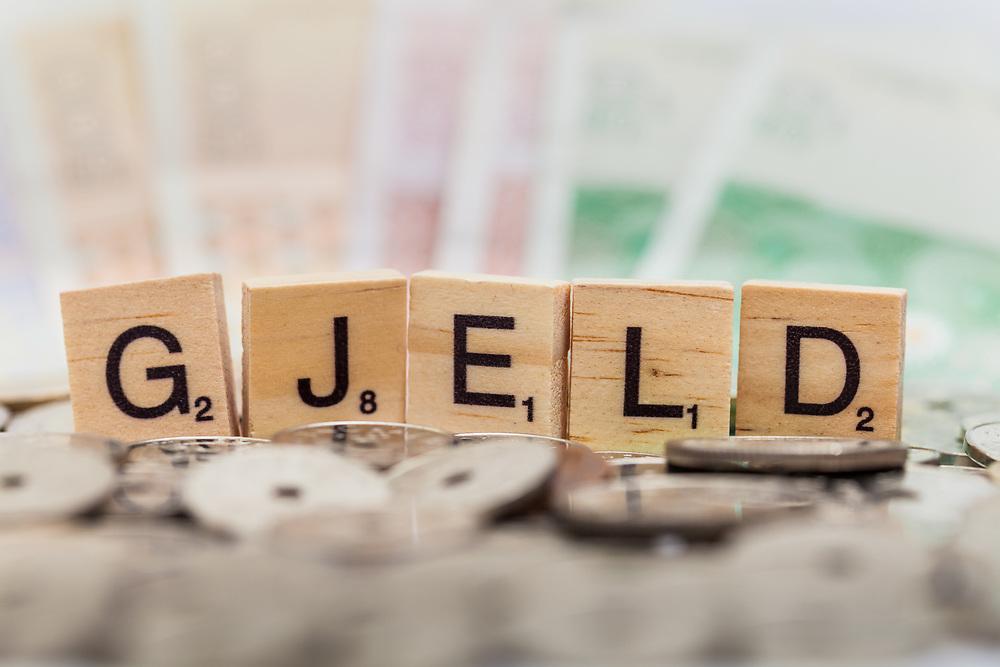 Ordbilde med ordet «gjeld», som kan brukes som illustrasjonsbilde for det meste som har med gjeld å gjøre. Selektiv fokus.