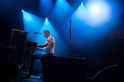 © Licensed to London News Pictures . 31/08/2013 . Rochdale , UK . Dan Gillespie Sells on the piano . The Feeling perform at a free gig in Rochdale . Photo credit : Joel Goodman/LNP