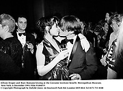 Allison Draper and Marc Romano kissing at the Costume Institute benefit. Metropolitan Museum. New York. 6 December 1993. Film 93204f15<br />