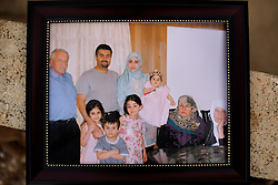 A photo of the deceased members of the Al-Akhrass family, killed during the war between Hezbollah and Israel, is seen in Aytaroun, Southern Lebanon, Oct. 23, 2006.