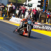 GAINESVILLE, FL - MAR 11, 2011:  Driver, Eddie Krawlec, brings his Pro Stock Motorcycle down the track during a qualifying run for the Tire Kingdom NHRA Gatornationals race in Gainesville, FL.