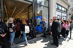 August 18, 2017 - London, London, UK - London, UK. Customers queue and enter the opening of H&M group's first Weekday clothing store in Regent Street.  Weekday is know for its denizens offerings and minimalist styles, with 27 stores throughout Europe. (Credit Image: © Ray Tang/London News Pictures via ZUMA Wire)