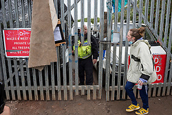 © Licensed to London News Pictures; 20/05/2021; Bristol, UK. People remonstrate with security guards at land off Glenfrome Road after police and bailiffs evicted squatters and their caravans from the site of a former gas works belonging to Wales and West. The site was occupied by around 75 people including children mostly living in vehicles and caravans.  Bailiffs brought in a crane to lift people off a scaffold tripod blocking the entrance to the site. Police led some occupants away and released them. The site was evicted last year. Photo credit: Simon Chapman/LNP.