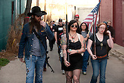 Johnny Shaver, Mallory Barton and Melanie Randolph lead the group during an open carry long rifle march demonstrating their 2nd amendment right to keep and bear arms on Thursday, January 31, 2013 in Fort Worth, Texas. (Cooper Neill/The Dallas Morning News)