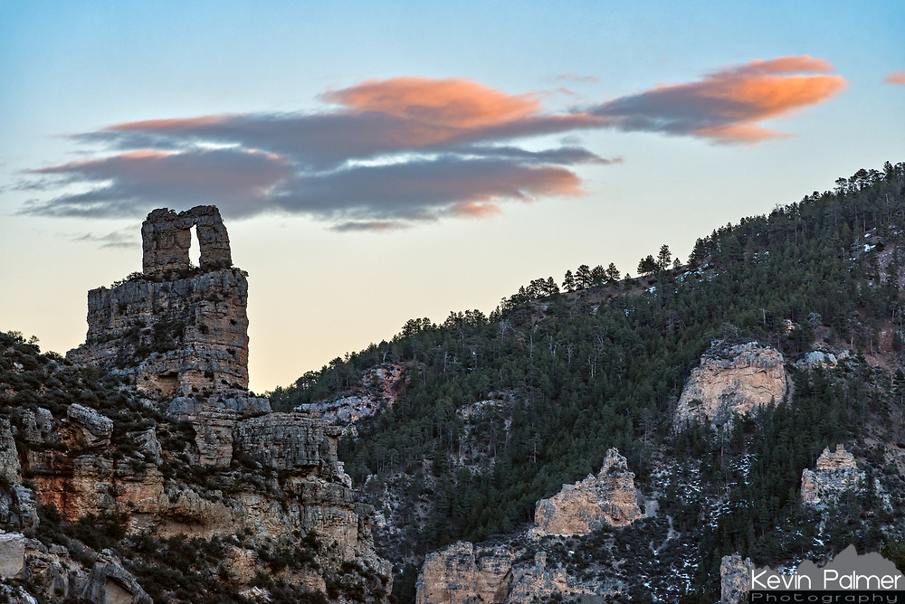 After coming around a bend in the trail in Tongue River Canyon, the Keyhole Arch came into view with some colorful clouds behind it.