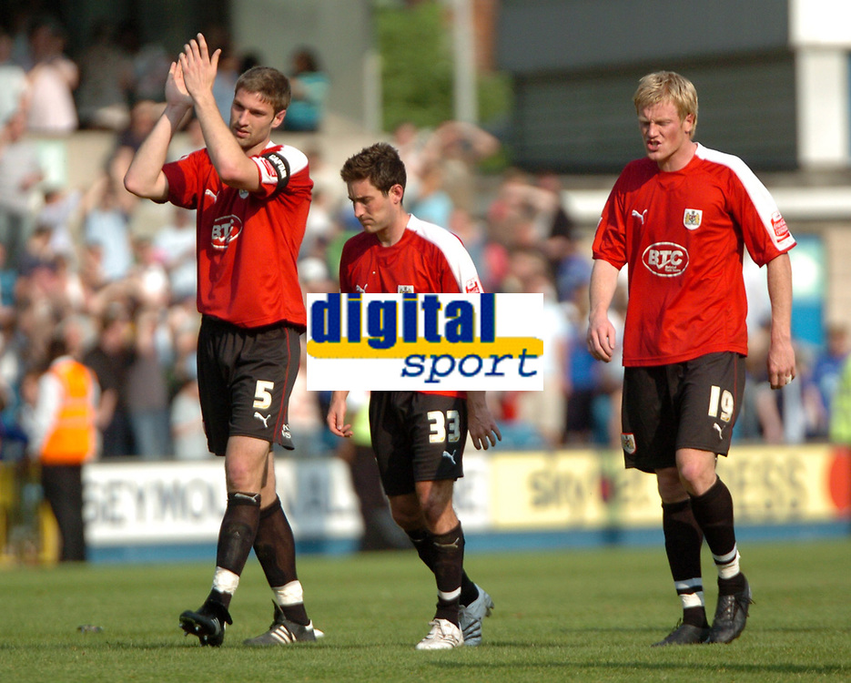 Photo: Tony Oudot.<br /> Millwall v Bristol City. Coca Cola League 1. 28/04/2007.<br /> Bristol City players Jamie McCombe, Lee Johnson and Andy Smith are dejected after the game