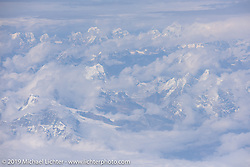 Flying over the Nepalese Himalayas in route from Chengdu, Chiina to Kathmandu, Nepal for Motorcycle Sherpa's Ride to the Heavens motorcycle adventure. Sunday, November 3, 2019. Photography ©2019 Michael Lichter.