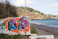 Street art grafitti on building at Killiney Beach in Dublin Ireland