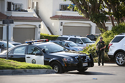 July 23, 2017 - Dana Point, CA, USA - An Orange County Sheriff's deputy walks around Tennis Villas at Monarch Beach neighborhood in Dana Point after neighbors heard two gunshots on Sunday, July 23, 2017. (Credit Image: © Kyusung Gong/The Orange County Register via ZUMA Wire)