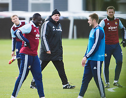 © London News Pictures. 28/01/2014. London, UK. Manager SAM ALLARDYCE (centre) with players George McCartney (second right) and team captain Kevin Nolan (far right) during West Ham United training at their training ground in Chadwell Heath, East London ahead of their premiership game away to Chelsea on tomorrow night (29/01/2014). Photo credit: Ben Cawthra/LNP