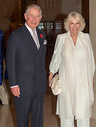 The Prince of Wales and the Duchess of Cornwall leave to attend a dinner with the Sultan of Oman during their official tour of the Middle East.