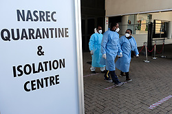 JOHANNESBURG, SOUTH AFRICA - JULY 03: Gauteng MEC Dr Bandile Masuku and health officials exit an inspection of Nasrec quarantine on July 03, 2020 in Johanneburg, South Africa. Gauteng MEC Dr Bandile Masuku visited the NASREC Quarantine Site to inspect facilities and monitor patient care experience. The site became operational on June 15. (Photo by Gallo Images/Dino Lloyd)