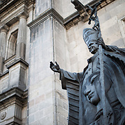 MEXICO CITY, MEXICO --A statue of Pope John Paul II outside the western side of the Metropolitan Cathedral in Mexico City. With 5 visits to Mexico during his tenure, Pope John Paul II is a particularly beloved pontiff in Mexico. Built in stages from 1573 to 1813, the Mexico City Metropolitan Cathedral is the largest Roman Catholic cathedral in the Americas. It sits in the heart of the historic quarter of Mexico City along one side of the the Zocalo.