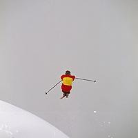 Mount Baker Ski Area, Washington. A skier catches big air off a jump.
