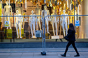 Now under new management, unclothed mannequins remain crowded together on the shop floor of fashion retailer Topshop on Oxford Street during the third lockdown of the Coronavirus pandemic, on 5th February 2021, in London, England. Asos struck a £295m deal to buy four brands from failed retail group Arcadia. The deal includes brands, Topshop, Topman, Miss Selfridge and HIIT brands, but not the shops, leaving thousands of jobs with uncertain futures.