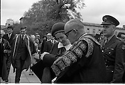 Belgian Royals King Baudouin and Queen Fabiola at Trinity College Dublin. Dr. F.H. Boland, Chancellor of Trinity College, shows a detail of his chancellor's hat to Queen Fabiola..15.05.1968