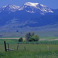 Fenced pastures spread below Hollow Top Mountain & Potosi Peak.