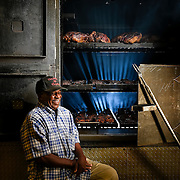 Bill Chaney's first job at age 12 was washing dishes at Arthur Bryant's (then owned by older brother Charlie, who had worked under the legend Henry Perry, a Carolina man who opened what is believed to be the city's first barbecue stand). Chaney, now 85 years old, worked for 25 cents, a barbecue sandwich and all the ice cream he could eat. He eventually became a contractor and brick layer, building brick pits for some of the city's most influential and longstanding barbecue restaurants.