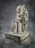 Ancient Egyptian statue of pharaoh Horemheb with god Amun, limestone, New Kingdom, 18th Dynasty, (1319-1292 BC). Egyptian Museum, Turin. <br /> <br /> Horemheb stands beside the taller depiction of the god Amun. The statue is typical of the period following the religious and artistic revolution of King Akhenaten. The muscles are not emphasised and the contours are soft, with rounded hips and juvenile faces, the eyes are almond shaped and the cheeks and lips sensual. Some scholars believe this may have been a statue of Tutenkhamon remodelled by Horemheb. Dorvetti collection. C 768
