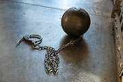 A ball and chain shackle in San Juan County Jail, which operated 1902-1920. San Juan County Historical Society Museum, Silverton, Colorado, USA. Silverton is a former silver mining camp, now the federally-designated Silverton Historic District. Durango is linked to Silverton by the Durango and Silverton Narrow Gauge Railroad, a National Historic Landmark. Silverton no longer has active mining, but subsists on tourism, maintenance of US 550 (which links Montrose with Durango), mine pollution remediation, and retirees.