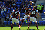 Cardiff City's Nathaniel Mendez-Laing (blue shirt) rises highest to head and score the opening goal. EFL Skybet championship match, Cardiff city v Aston Villa at the Cardiff City Stadium in Cardiff, South Wales on Saturday 12th August 2017.<br /> pic by Carl Robertson, Andrew Orchard sports photography.