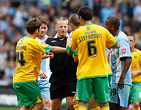 Photo: Richard Lane/Richard Lane Photography. Coventry City v Norwich City. Coca-Cola Championship. 09/08/2008. Referee, C. Taylor is surrounded by players from both teams as a few bad challenges are made.