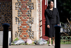 © Licensed to London News Pictures. 22/06/2020. Reading, UK. Home Secretary PRITI PATEL walks past  flowers placed at the scene, during a visit to Forbury Gardens in Reading town centre where three people were stabbed to death in a terrorist attack. Several other people were injured in the attack which was carried out by Libyan asylum seeker Khairi Saadallah, who is currently in custody. . Photo credit: Ben Cawthra/LNP