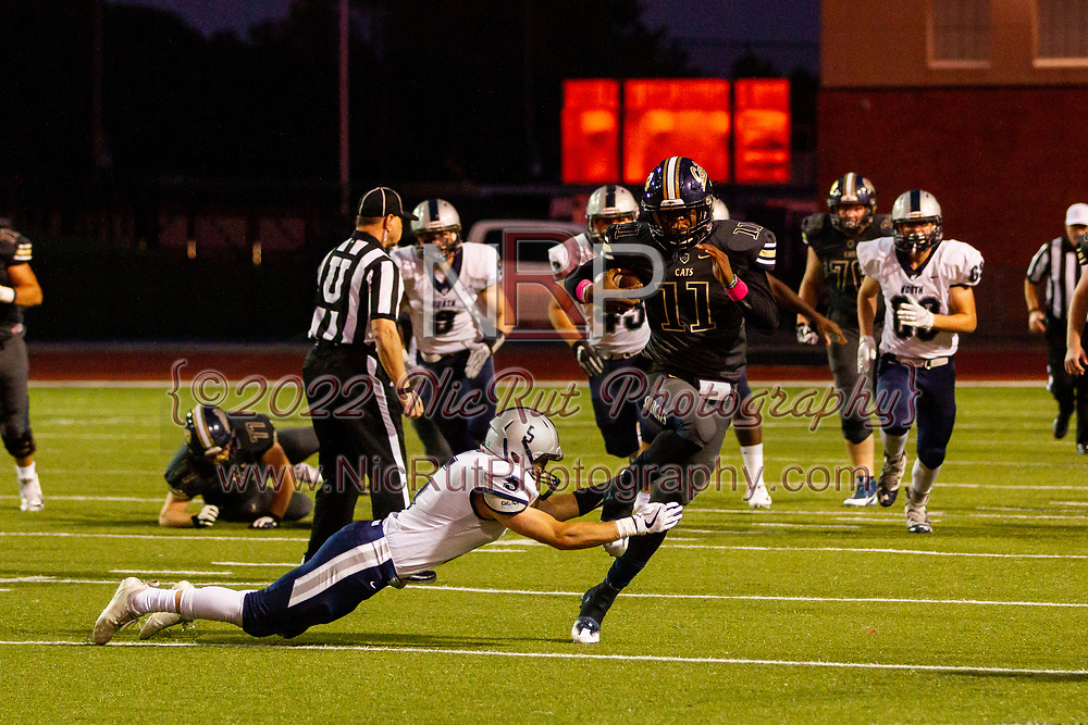 Southmoore's Jaedyn Scott leaping over Edmond North's Russell Dilks for a big gain of yards during the game on, Friday, October 19, 2018, at Moore Stadium.