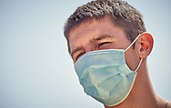 Man wearing a protective medical face mask