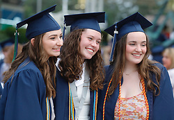 Sydney Rodgers, Riley Horne and Caroline Hammond pose for a photo  before a graduation ceremony at the Cynthia Woods Mitchell Pavilion, Monday, May 24, 2021, in The Woodlands.
