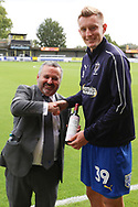 AFC Wimbledon striker Joe Pigott (39) recieving a bottle of wine for player of the month during the EFL Sky Bet League 1 match between AFC Wimbledon and Scunthorpe United at the Cherry Red Records Stadium, Kingston, England on 15 September 2018.