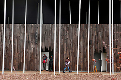 Licensed to London News Pictures 21/12/2013<br /> Wiltshire, UK.<br /> Visitors walk past one of the vistas of the new visitors centre at the Stonehenge site, that was opened to the public on the 18th December 2013. The centre cost £27m, and holds a permanent exhibition that includes many objects found at the Stonehenge site. The most spectular is the skeleton, excavated in 1863 from a long barrow burial mound at Winterborne.<br /> Photo: Anna Branthwaite/LNP