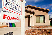 "26 DECEMBER 2010 - MARICOPA, AZ: A foreclosed home for sale one block from the home BRISTOL PALIN, 20, bought in Maricopa, AZ, for $172,000. The former contestant on ""Dancing with the Stars"" and daughter of Sarah Palin, former governor of Alaska, former Republican Vice Presidential candidate, reality television star, best selling author and supporter of the Tea Party movement. Bristol Palin paid $172,000 cash for the two-level, 3,900-square-foot, brown stucco house with a tile roof, 2 1/2 baths, a three-car garage, landscaped front and back yards, and access to a community pool. Local media reported that the home was built in 2006, at the peak of the Arizona real estate boom, and was bought for a little under $330,000 at the time. According to paperwork filed with the Pinal County Recorder's Office, Palin closed on the home in early December, buying it from Michael and Cynthia Smith, North Dakota investors who bought the home when it was in foreclosure. The home is in the Cobblestone Farms development in Maricopa, about 40 miles from Phoenix. Maricopa was a small farming community until the late 1990's when land speculators starting buying up the farms and turning them into subdivisions. Growth in Maricopa boomed from 2002 until 2008 when the recession, foreclosure and banking crisis hit. Since then it has had one of the highest foreclosure rates in the United States. Now investors are starting to buy foreclosed homes in Maricopa, anticipating the end of the foreclosure crisis. Homes in Maricopa are now selling for about less than half of what they cost in 2006. Bristol Palin has not commented publicly on the purchase and has not said if the home is an investment or if she plans to live in it. PHOTO BY JACK KURTZ"